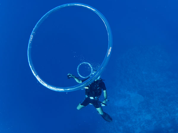 A Phuket Divemaster blowing bubble rings
